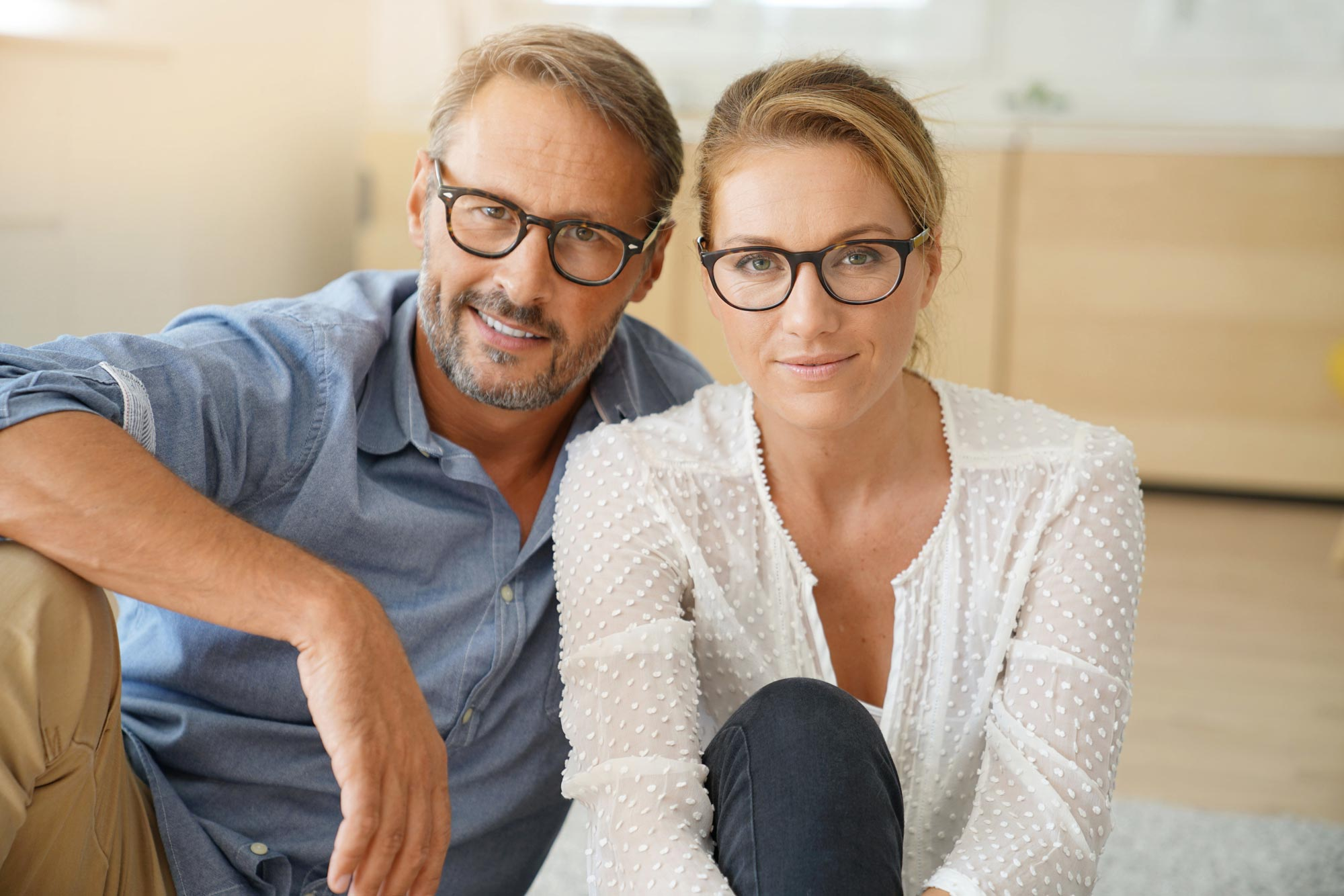 Couple wearing glasses - eye doctor